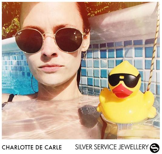 Charlotte de Carle wears our Silver Hoop Earrings With Brass Cross